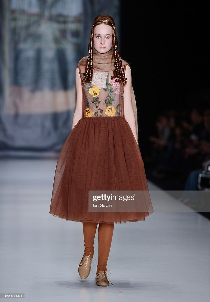 A model walks the runway at the Tatyana Parfionova show during Mercedes-Benz Fashion Week Russia Fall/Winter 2013/2014 at Manege on March 31, 2013 in Moscow, Russia.