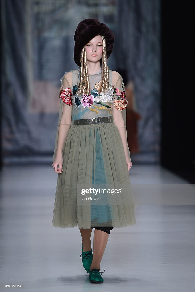 A model walks the runway at the Tatyana Parfionova show during MercedesBenz Fashion Week Russia Fall/Winter 2013/2014 at Manege on March 31 2013 in...