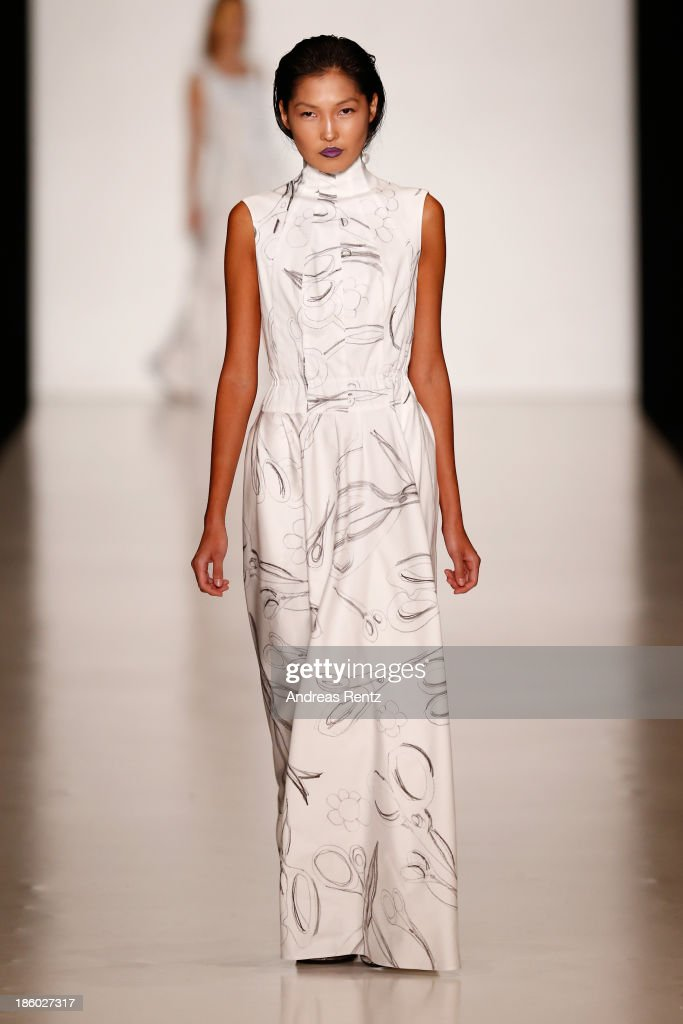 A model walks the runway at the Tatyana Parfionova show during Mercedes-Benz Fashion Week Russia S/S 2014 on October 27, 2013 in M