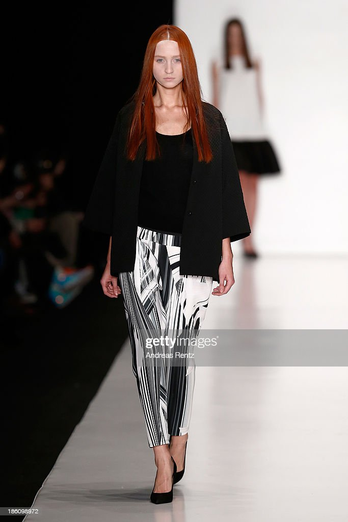 A model walks the runway at the Tegin show during Mercedes-Benz Fashion Week Russia S/S 2014 on October 28, 2013 in Moscow, Russia.