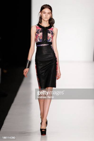 A model walks the runway at the Tel Aviv Fashion Week Collections show during MercedesBenz Fashion Week Russia S/S 2014 on October 28 2013 in Moscow...