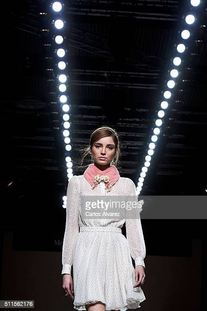 A model walks the runway at the Teresa Helbig show during the MercedesBenz Madrid Fashion Week Autumn/Winter 2016/2017 at Ifema on February 21 2016...