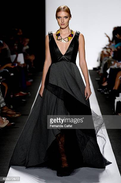 A model walks the runway at the The Art Institutes fashion show during MercedesBenz Fashion Week Spring 2015 at The Theatre at Lincoln Center on...