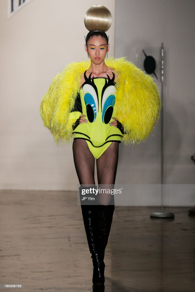 A model walks the runway at the The Blonds show during Spring 2014 Spring 2014 MADE Fashion Week at Milk Studios on September 11, 2013 in New York City.