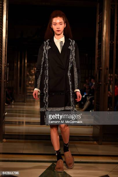 A model walks the runway at the Theo VII show during the London Fashion Week February 2017 collections on February 19 2017 in London England