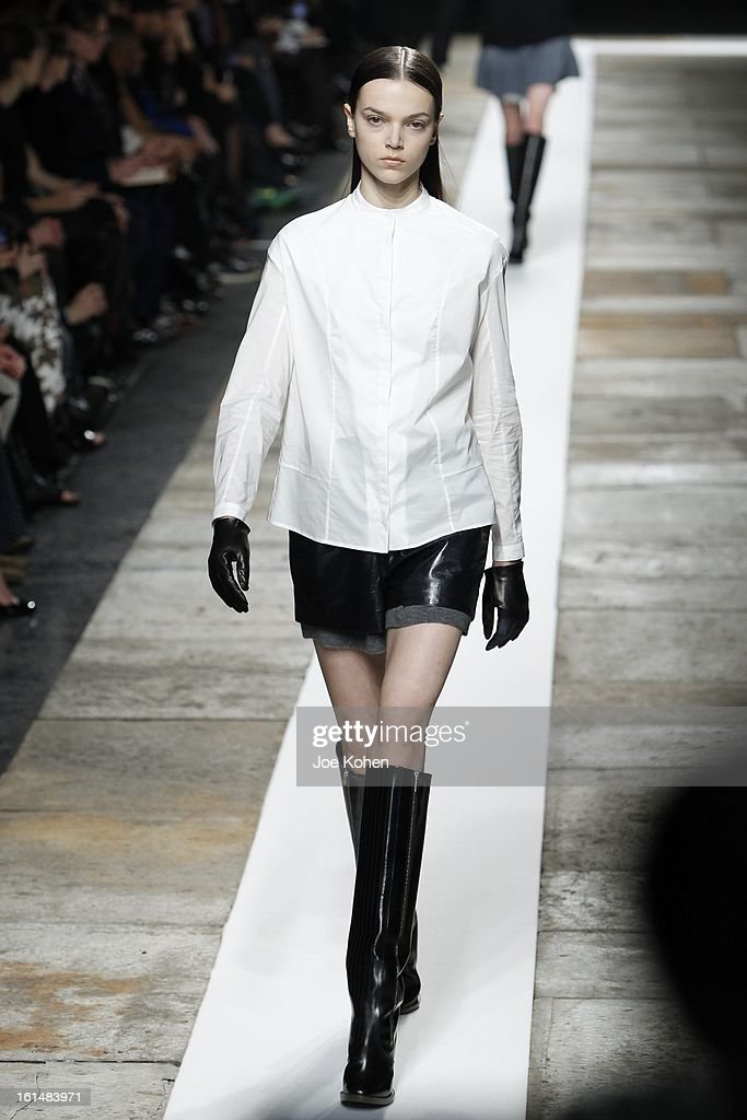 A model walks the runway at the Theyskens' Theory fall 2013 fashion show during Mercedes-Benz Fashion Week at Skylight at Moynihan Station on February 11, 2013 in New York City.