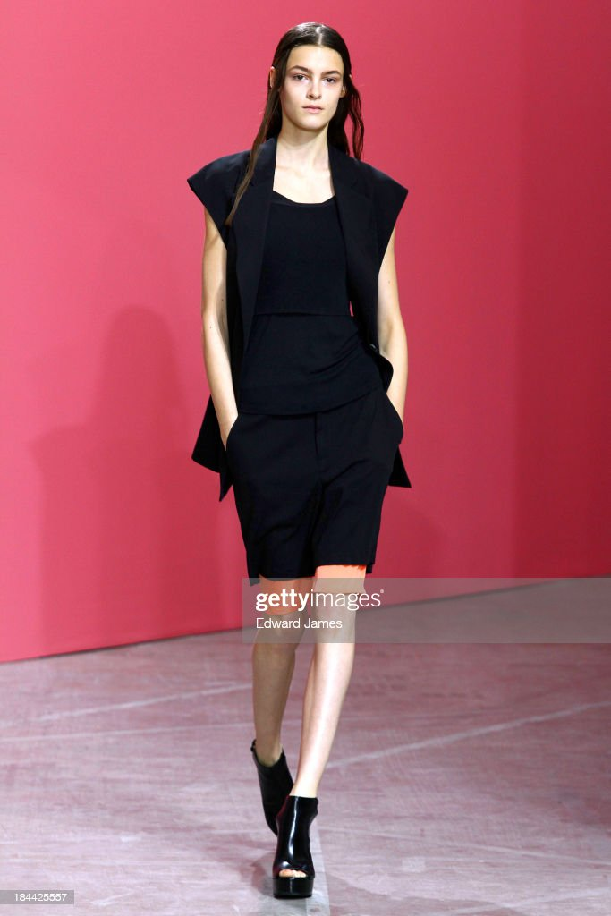 A model walks the runway at the Theyskens' Theory fashion show during Mercedes-Benz Fashion Week Spring 2014 on September 9, 2013 in New York City.