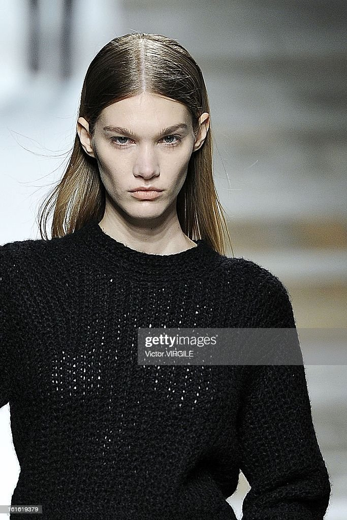 A model walks the runway at the Theyskens' Theory Ready to Wear Fall/Winter 2013-2014 fashion show during Mercedes-Benz Fashion Week at Skylight at Moynihan Station on February 11, 2013 in New York City.