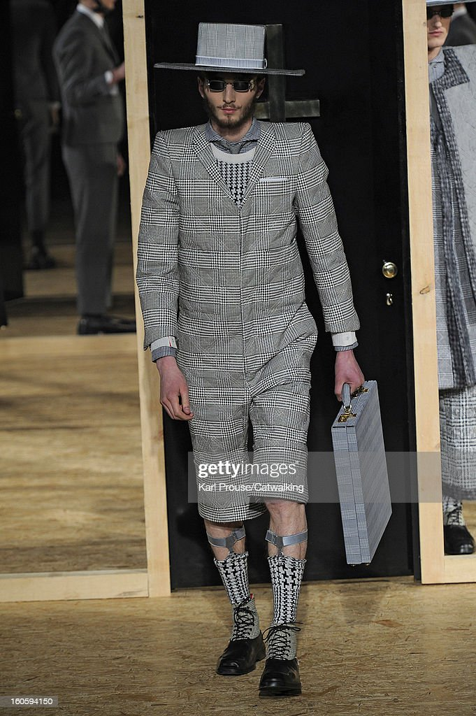 A model walks the runway at the Thom Browne Autumn Winter 2013 fashion show during Paris Menswear Fashion Week on January 20, 2013 in Paris, France.