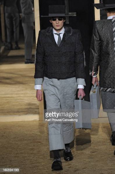 A model walks the runway at the Thom Browne Autumn Winter 2013 fashion show during Paris Menswear Fashion Week on January 20 2013 in Paris France