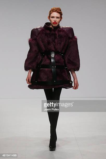 A model walks the runway at the Thomas Hanisch show during the MercedesBenz Fashion Week Berlin Autumn/Winter 2015/16 at Brandenburg Gate on January...