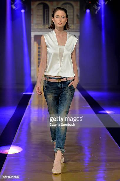 A model walks the runway at the Thomas Rath Show during Platform Fashion Dusseldorf on July 27 2014 in Duesseldorf Germany