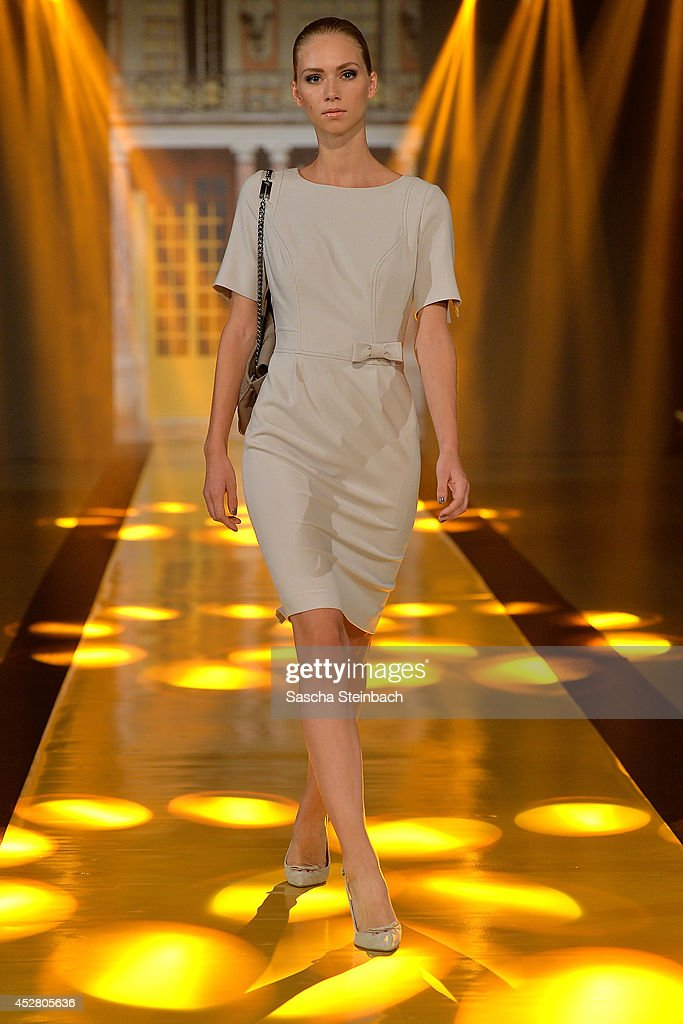 A model walks the runway at the Thomas Rath Show during Platform Fashion Dusseldorf on July 27, 2014 in Duesseldorf, Germany.