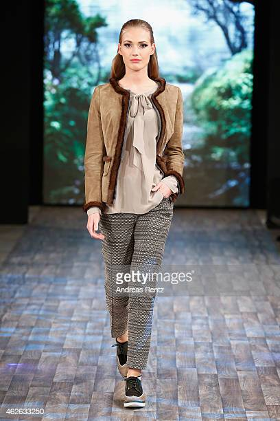 A model walks the runway at the Thomas Rath show during the Platform Fashion February 2015 on February 1 2015 in Duesseldorf Germany