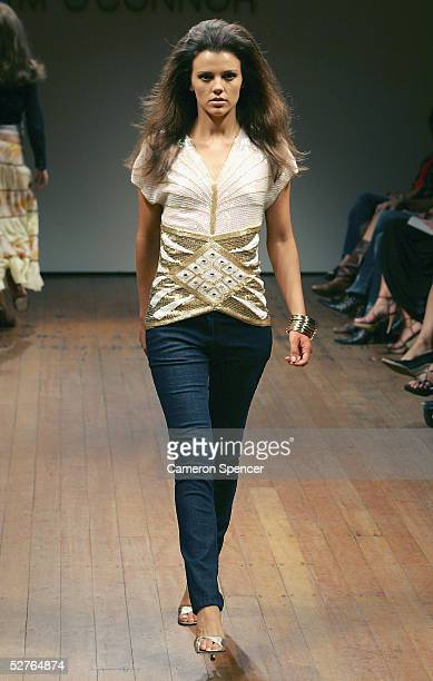 A model walks the runway at the Tim O'Connor collection presentation at the Billich Gallery during the Mercedes Australian Fashion Week May 6 2005 in...