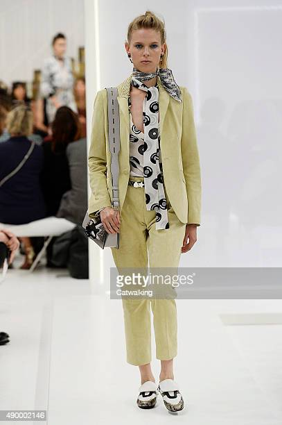 A model walks the runway at the Tod's Spring Summer 2016 fashion show during Milan Fashion Week on September 25 2015 in Milan Italy