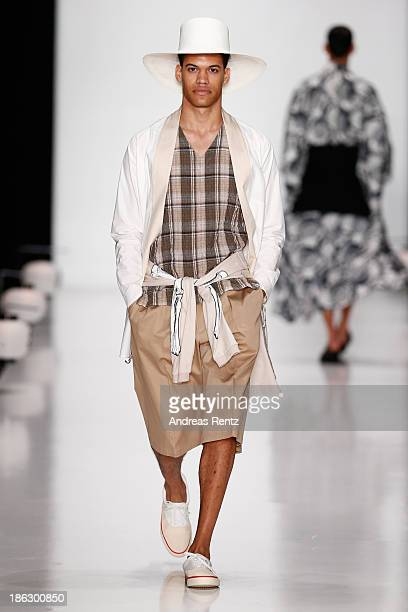A model walks the runway at the Tokyo Fashion Week Collections show MercedesBenz Fashion Week Russia S/S 2014 during on October 30 2013 in Moscow...