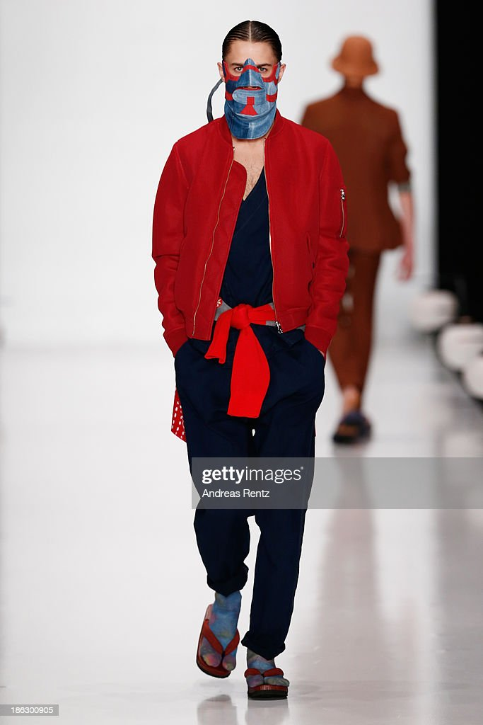 A model walks the runway at the Tokyo Fashion Week Collections show Mercedes-Benz Fashion Week Russia S/S 2014 during on October 30, 2013 in Moscow, Russia.