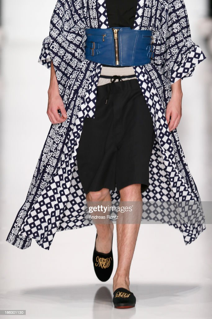 A model (detail) walks the runway at the Tokyo Fashion Week Collections show Mercedes-Benz Fashion Week Russia S/S 2014 during on October 30, 2013 in Moscow, Russia.