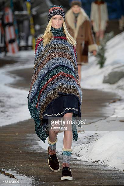 A model walks the runway at the Tommy Hilfiger Autumn Winter 2014 fashion show during New York Fashion Week on February 10 2014 in New York United...