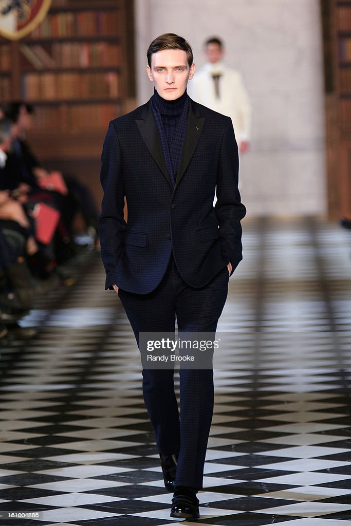 A model walks the runway at the Tommy Hilfiger Fall 2013 Men's Collection fashion show during Mercedes-Benz Fashion Week at Park Avenue Armory on February 8, 2013 in New York City.