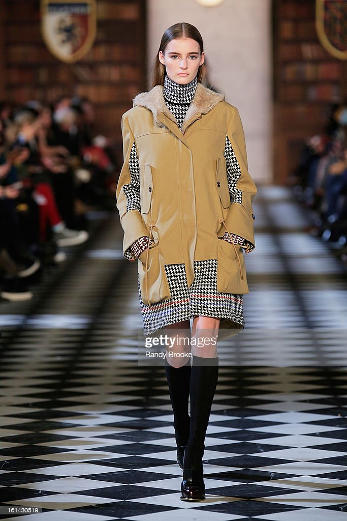 A model walks the runway at the Tommy Hilfiger Fall 2013 Women's Collection fashion show during Mercedes-Benz Fashion Week at the Park Avenue Armory on February 10, 2013 in New York City.