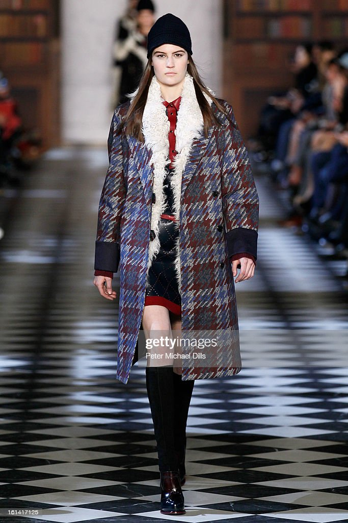 A model walks the runway at the Tommy Hilfiger Women's Fall 2013 fashion show during Mercedes-Benz Fashion Week at Park Avenue Armory on February 10, 2013 in New York City.