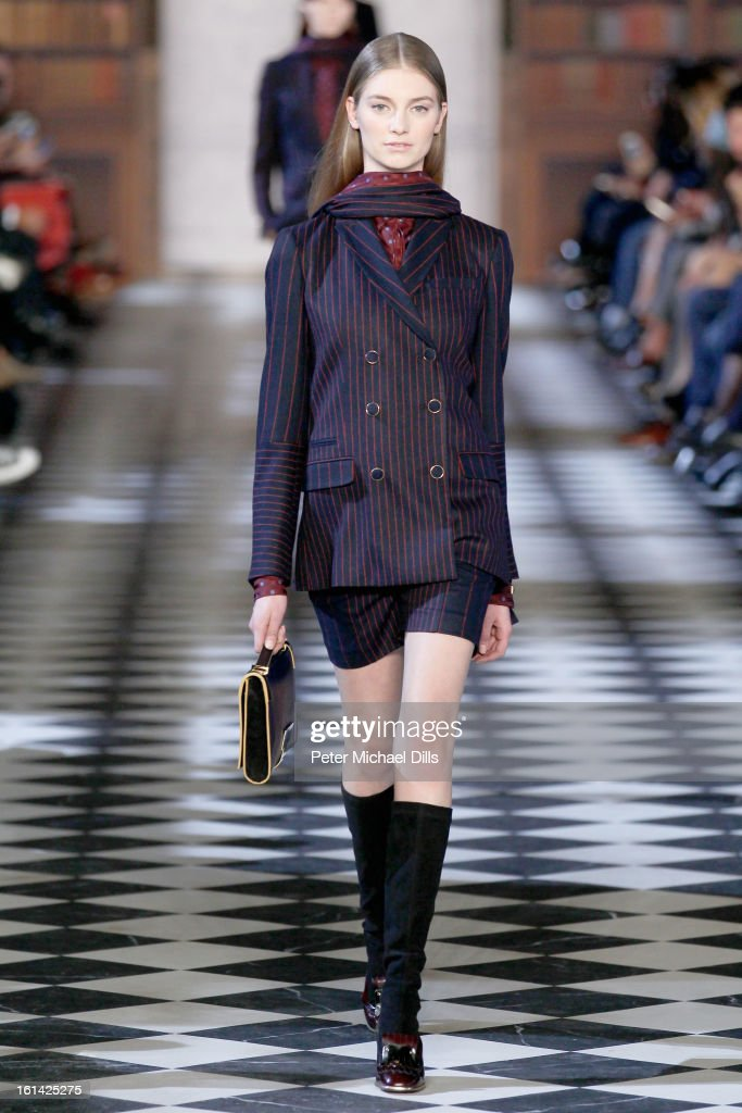 A model walks the runway at the Tommy Hilfiger Women's Fall 2013 fashion show during Mercedes-Benz Fashion Week at at Lincoln Center on February 10, 2013 in New York City.