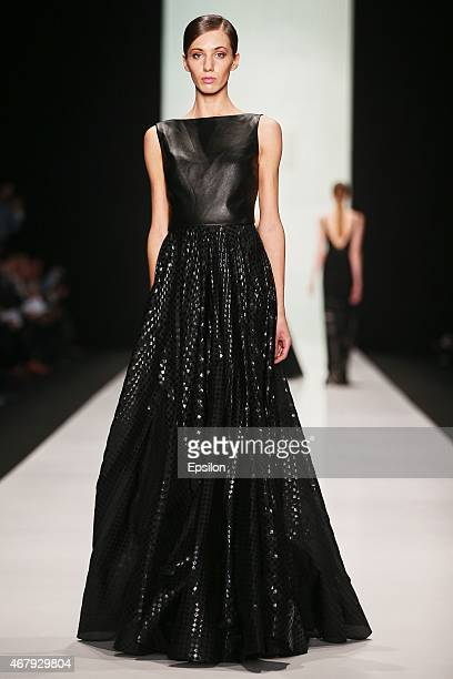 A model walks the runway at the Tony Ward Couture show during the MercedesBenz Fashion Week Russia Autumn/Winter 2015/16 at Manege on March 28 2015...