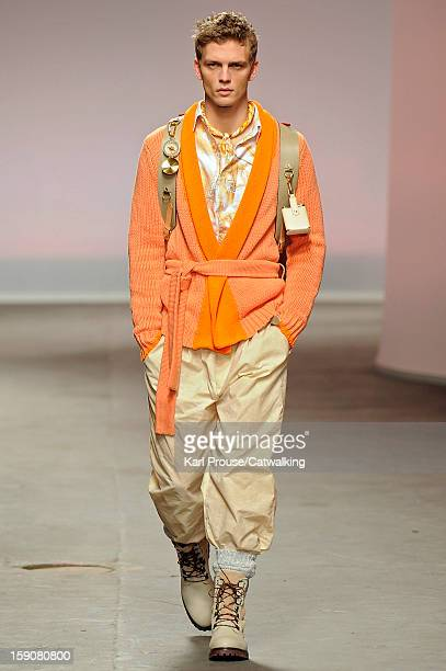A model walks the runway at the Topman Design Autumn Winter 2013 fashion show during London Menswear Fashion Week on January 7 2013 in London United...