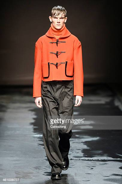 A model walks the runway at the TOPMAN Design Autumn Winter 2014 fashion show during London Menswear Fashion Week on January 6 2014 in London United...