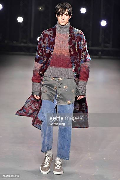 A model walks the runway at the Topman Design Autumn Winter 2016 fashion show during London Menswear Fashion Week on January 8 2016 in London United...
