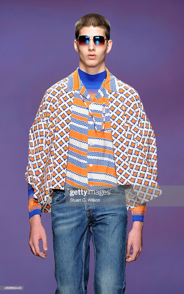 A model walks the runway at the TOPMAN Design show during the London Collections: Men SS15 on June 15, 2014 in London, England.