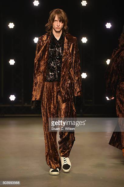 A model walks the runway at the TOPMAN Design show during The London Collections Men AW16 at Topman Show Space on January 8 2016 in London England