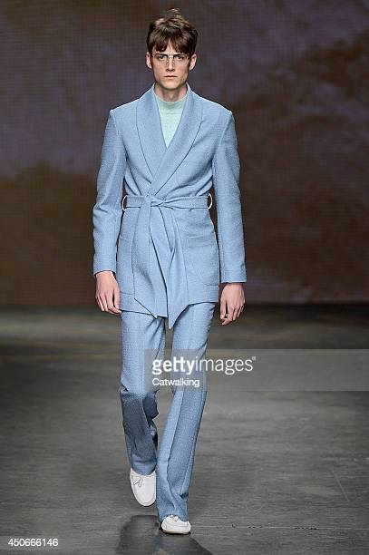 A model walks the runway at the Topman Design Spring Summer 2015 fashion show during London Menswear Fashion Week on June 15 2014 in London United...