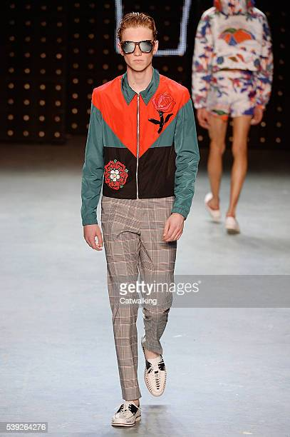 A model walks the runway at the Topman Design SS 2017 fashion show during London Menswear Fashion Week on June 10 2016 in London United Kingdom