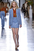 A model walks the runway at the Topshop Unique Autumn Winter 2015 fashion show during London Fashion Week on February 22 2015 in London United Kingdom