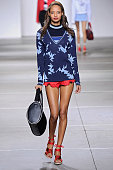 A model walks the runway at the Topshop Unique Red Label Spring Summer 2015 fashion show during London Fashion Week on September 14 2014 in London...