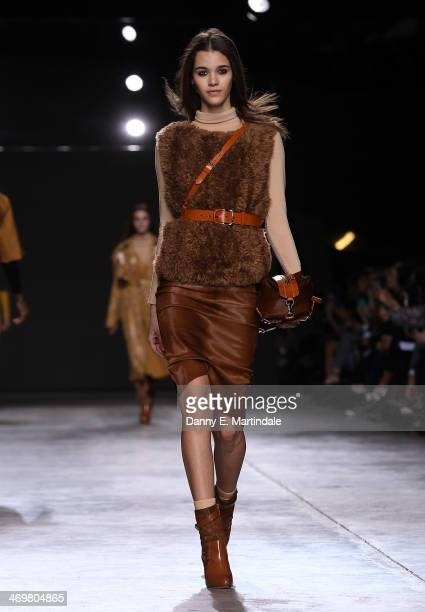 A model walks the runway at the Topshop Unique show at London Fashion Week AW14 at Tate Modern on February 16 2014 in London England