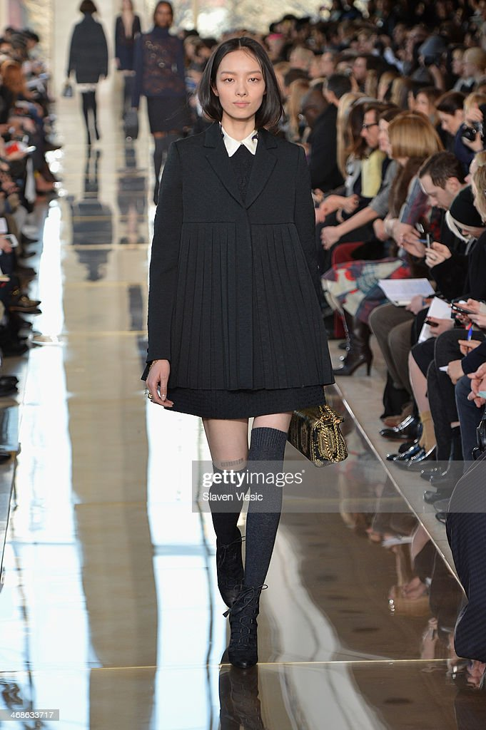 A model walks the runway at the Tory Burch fashion show during Mercedes-Benz Fashion Week Fall 2014 at Avery Fisher Hall at Lincoln Center for the Performing Arts on February 11, 2014 in New York City.