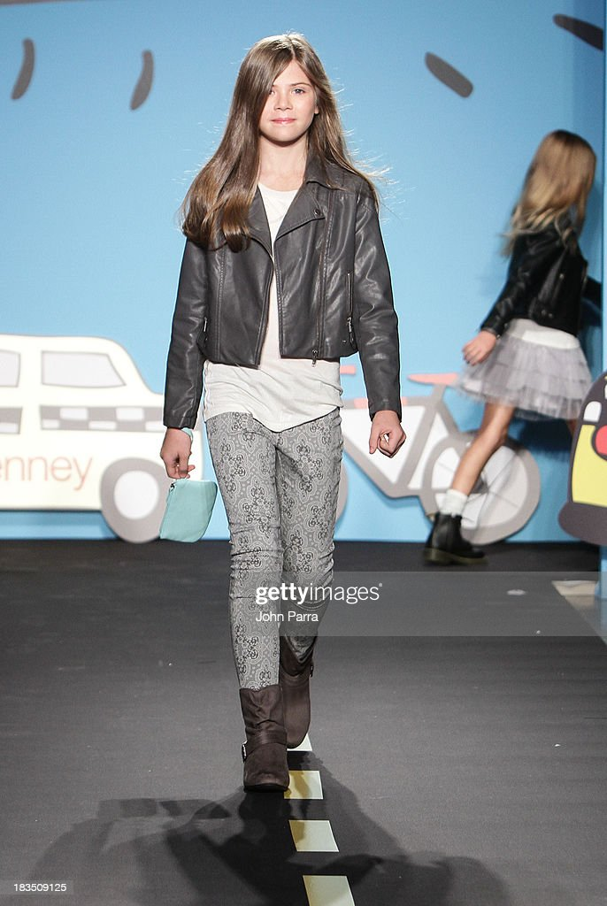 A model walks the runway at the Total Girl TG preview during JCPenney showcase at petiteParade Kids Fashion Week in Collaboration with VOGUEbambini at Industria Superstudio on October 6, 2013 in New York City.