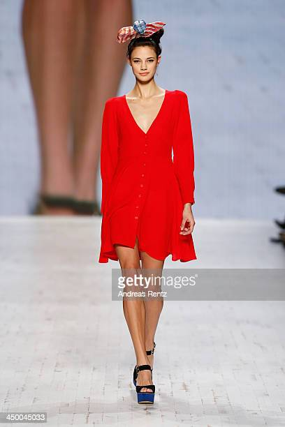 A model walks the runway at the Toujours Toi Family Affairs show during MercedesBenz Fashion Days Zurich 2013 on November 16 2013 in Zurich...