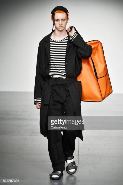 A model walks the runway at the Tourne de Transmission Spring Summer 2018 fashion show during London Menswear Fashion Week on June 9 2017 in London...