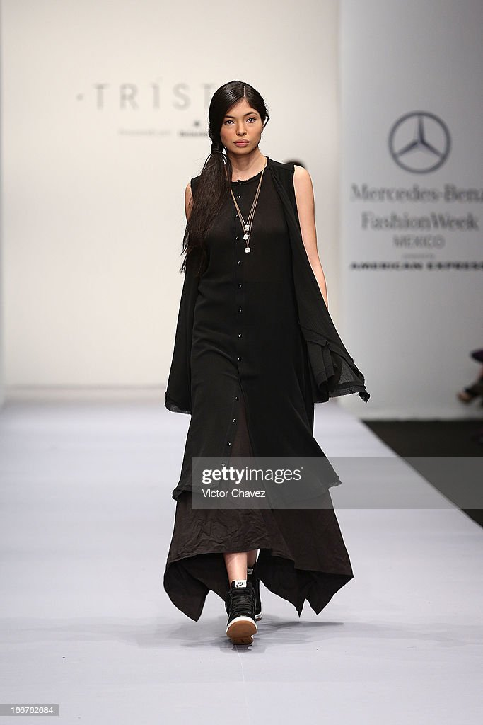 A model walks the runway at the Trista Fall/Winter 2013 collection during the first day of Mereceds-Benz Fashion Week Mexico at Carpa Santa Fe on April 15, 2013 in Mexico City, Mexico.