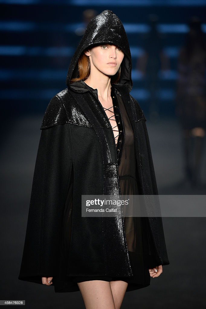 A model walks the runway at the Triton fashion show during Sao Paulo Fashion Week Winter 2015 at Parque Candido Portinari on November 5 2014 in Sao...