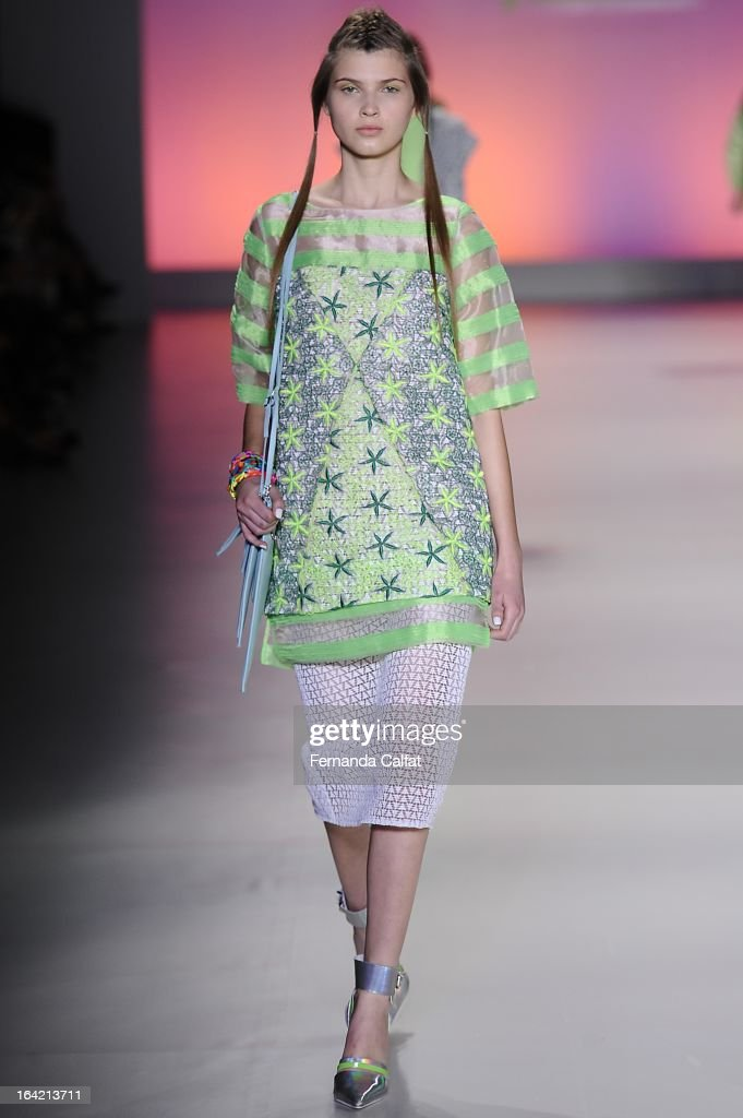 A model walks the runway at the Triton show during Sao Paulo Fashion Week Summer 2013/2014 on March 20, 2013 in Sao Paulo, Brazil.
