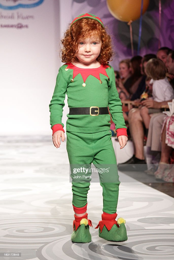 A model walks the runway at the Truly Scrumptious for Babies 'R' Us designed by Heidi Klum at Vogue Bambini petiteParade Kids Fashion Week on October 5, 2013 in New York City.