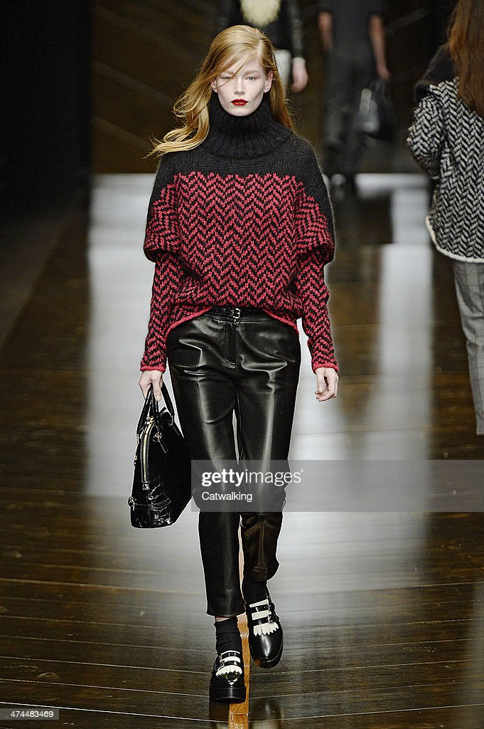 A model walks the runway at the Trussardi Autumn Winter 2014 fashion show during Milan Fashion Week on February 23, 2014 in Milan, Italy.
