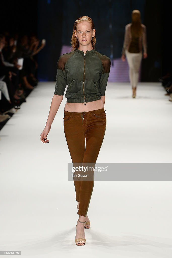 A model walks the runway at the Tuba Ergin show during Mercedes-Benz Fashion Week Istanbul s/s 2014 Presented By American Express on October 10, 2013 in Istanbul, Turkey.