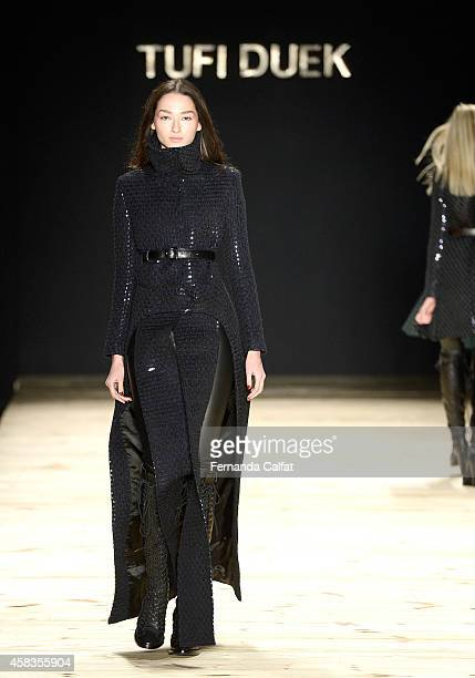 A model walks the runway at the Tufi Duek fashion show during Sao Paulo Fashion Week Winter 2015 at Parque Candido Portinari on November 3 2014 in...